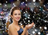 Smiling woman in evening dress with diamond — Stock Photo