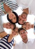 Smiling friends in circle — Stock Photo