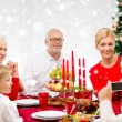 Smiling family having holiday dinner at home — Stock Photo #58825961