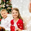 Smiling family having holiday dinner at home — Stock Photo #58826035