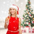 Woman in red dress with glass of champagne — Stock Photo #58827225