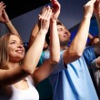 Smiling friends at concert in club — Stock Photo #58829123