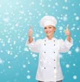 Smiling female chef showing thumps up — Stock Photo