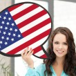 Smiling woman with text bubble of american flag — Stock Photo #58897573