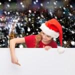 Girl in santa helper hat with blank white board — Stock Photo #58898519