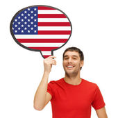Smiling man with text bubble of american flag — Stock Photo