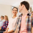 Group of smiling students in lecture hall — Stock Photo #58907415