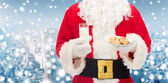 Santa claus with glass of milk and cookies — Stock Photo