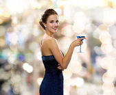 Smiling woman holding cocktail — Stock Photo