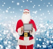Man in costume of santa claus with tablet pc — Stock Photo