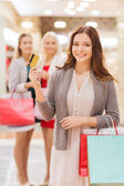 Women with shopping bags and credit card in mall — Foto Stock