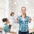 Smiling girl showing thumbs up at school classroom — Stock Photo #58975115