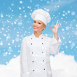 Smiling female chef showing ok hand sign — Foto de Stock   #58975341
