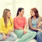 Three girlfriends having a talk at home — Stock Photo #58977989