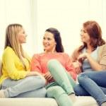 Three girlfriends having a talk at home — Stock Photo #58978021