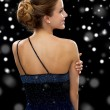 Smiling woman in evening dress — Stock Photo #58978423