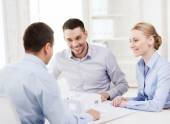 Couple looking at model of their house at office — Stock Photo
