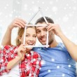 Smiling couple with house made of measuring tape — Stock Photo #59032583