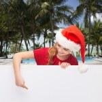 Girl in santa helper hat with blank white board — Stock Photo #59044767