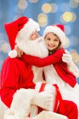 Smiling little girl with santa claus — Stock Photo