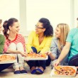 Five smiling teenagers eating pizza at home — Stock Photo #59098993