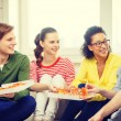 Five smiling teenagers eating pizza at home — Stock Photo #59099001