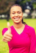 Smiling african american woman showing thumbs up — Stock Photo