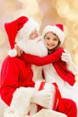 Smiling little girl with santa claus — 图库照片