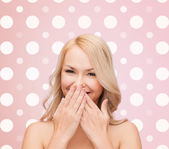 Beautiful young woman over polka dot background — Stock Photo