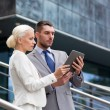Businesspeople with tablet pc outdoors — Stock Photo #59111541