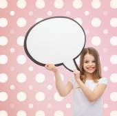 Smiling little girl with blank text bubble — Stock Photo