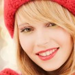Close up of smiling young woman in winter clothes — Stock Photo #59269835