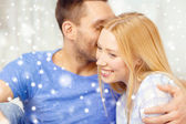 Happy couple hugging at home — Stock Photo