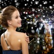 Smiling woman in evening dress — Stock Photo #59308905