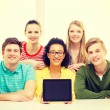 Smiling students showing tablet pc blank screen — Stock Photo #59311905