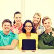 Smiling students showing tablet pc blank screen — Stock Photo #59311963
