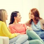 Three girlfriends having a talk at home — Stock Photo #59312761