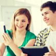 Smiling students with tablet pc at school — Stock Photo #59314433