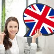 Smiling woman with text bubble of british flag — Stock Photo #59316487