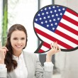 Smiling woman with text bubble of american flag — Stock Photo #59316535