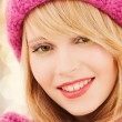 Close up of smiling young woman in winter clothes — Stock Photo #59320331