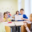 Group of school kids writing test in classroom — Stock Photo #59322707