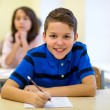 Group of school kids writing test in classroom — Stock Photo #59323201