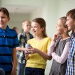 Group of school kids with soda cans in corridor — Stock Photo #59323491