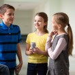 Group of school kids with soda cans in corridor — Stock Photo #59323501