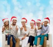 Happy family sitting on couch — Stock Photo