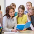 Group of school kids with teacher in classroom — Stock Photo #59388327