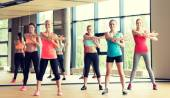 Group of women working out in gym — Stock Photo
