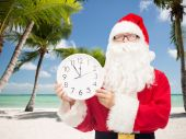 Man in costume of santa claus with clock — Fotografia Stock
