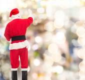 Man in costume of santa claus writing something — Fotografia Stock